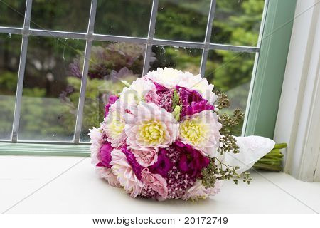 bride's bouquet sitting on window ledge