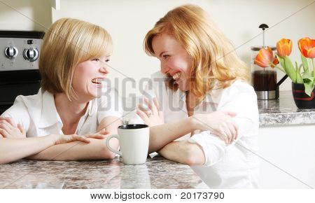 best friends having a laugh in the kitchen