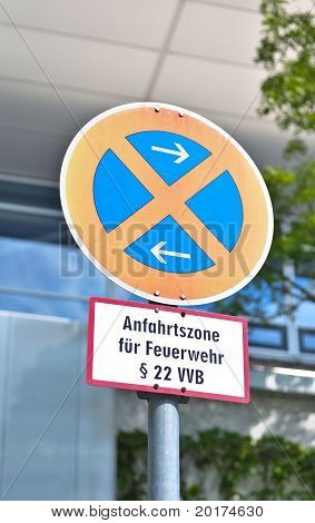 "Traffic sign ""the stop is forbidden"" against office building"