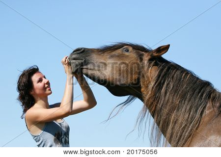 young girl and the horse in field