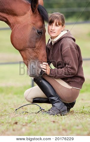 inseparable - young girl and bay horse in field