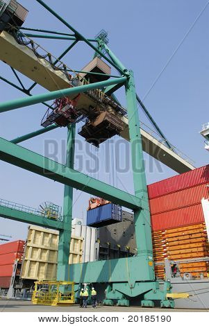 crane hoisting container from beneath