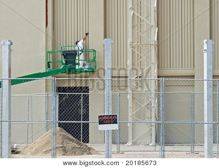 Painter at Construction Site