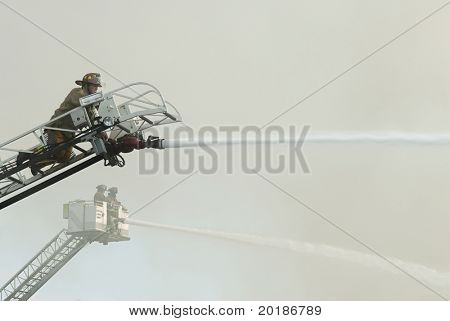 DAYTON, OHIO - AUGUST 15: Firemen on duty battle a warehouse fire from aerial ladders on August 15, 2008 in Dayton, Ohio, USA.