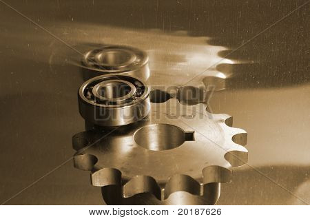 gears and ball-bearing in a sepia cast