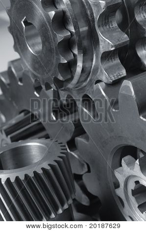 menagerie of cogwheels, gears connecting in black and white