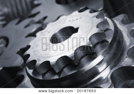 four gears, cogwheels connecting in close-ups