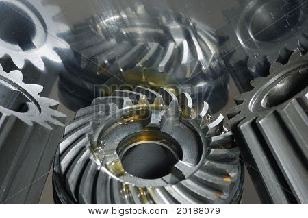gears from gearbox-concept with oil mirrored in titanium