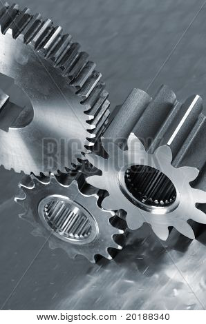 gear-machinery against brushed aluminum in blue cast