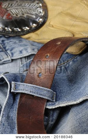 jeans, denim with leather belt and buckle and leather gloves