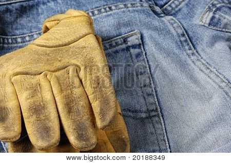 worn jeans with leather glves in back-pocket