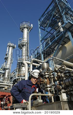 engineer, working with pipeline controls inside oil and gas refinery