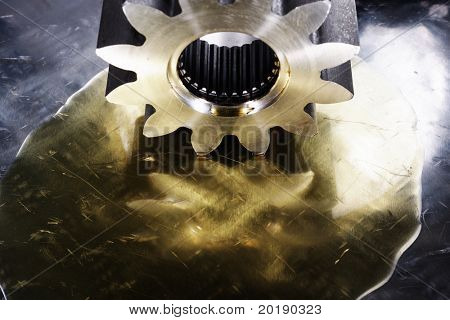 large industrial gear drenched in lubricant oil