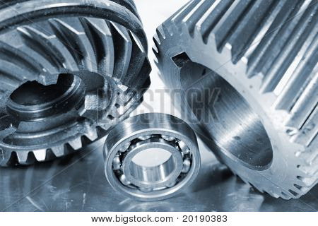 large industrial gears and ball-bearing in a metal blue toning idea