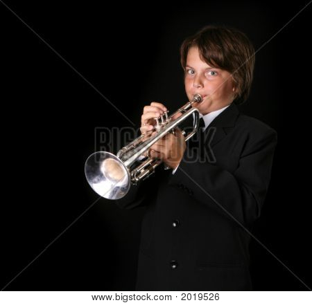 Portrait Of A Boy Playing Trumpet