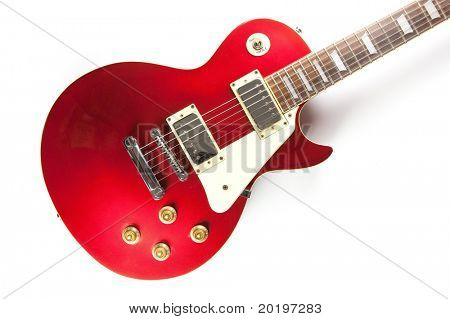 Vintage red electric solid body guitar, isolated on white.