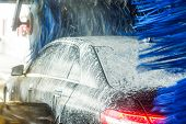 Car Wash, Black Car In Automatic Car Wash, Rotating Red And Blue Brush. Washing Vehicle. poster