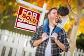 Young Mixed Race Chinese and Caucasian Father and Son In Front of Sold For Sale Real Estate Sign and poster