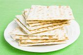 stock photo of piety  - Pile of Jewish Matza bread on a plate - JPG