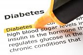 stock photo of diabetes symptoms  - Definition of the word Diabetes highlighted in orange with felt tip pen - JPG