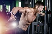Muscular Handsome Athletic Bodybuilder Fitness Model Posing After Exercises In Gym On Diet . poster