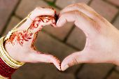 foto of indian wedding  - ceremonial wedding hands in shape of heart one male one female coming together to form heart - JPG