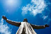 stock photo of corazon  - Jesus Christ sculpture on top of Sagrat Corazon chirch on Tibidabo mountainBarcelonaSpain - JPG