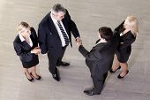 foto of business meetings  - Representatives of two companies shaking hands - JPG