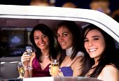 picture of ladies night  - girls drinking in a night out in a limousine