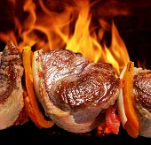 picture of flame-grilled  - barbecue on flaming hot - JPG