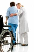 stock photo of physical therapist  - nurse helps a senior woman on crutches - JPG