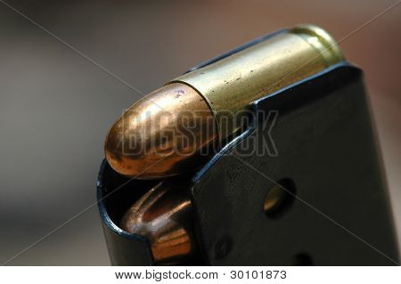 close-up 9mm caliber bullets in a charger