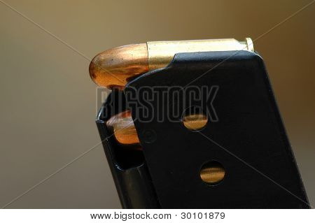 close-up 9mm caliber bullets in a charger Image ID: 3484