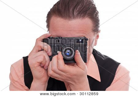 Photographer Is Focusing A Rangefinder Camera