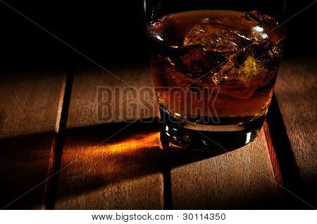 A Glass Of Wiskey With Ice