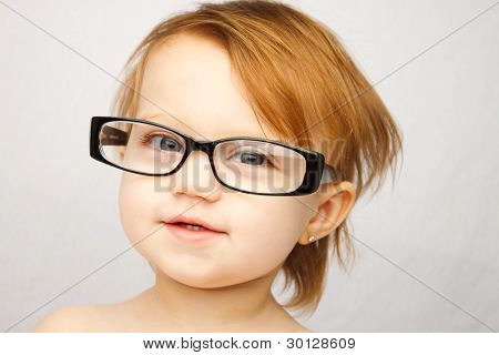 Adorable Little Girl With Large Glasses