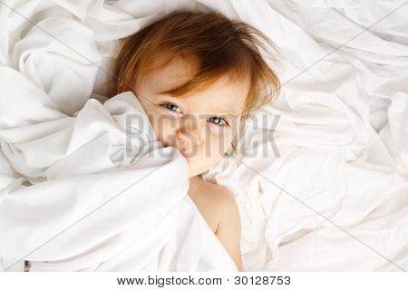 Beautiful Child Wrapped In White Sheets