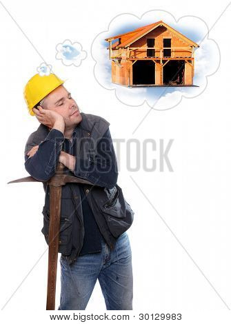Tired construction worker dreaming on his pick axe.