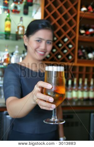 Bartender Giving A Glass Of Beer