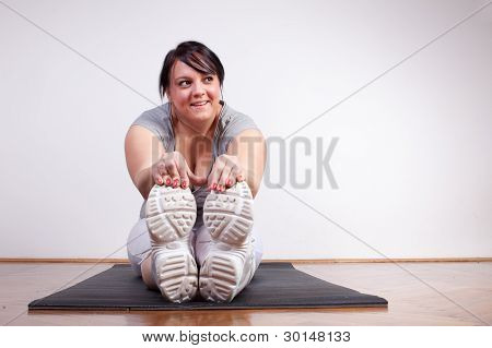 Happy Overweight Woman Exercising/stretching