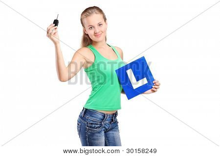 A teenager holding a L plate and car key isolated on white background