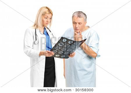 Senior man with a female doctor, looking at the results of his CT scan isolated on white background