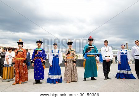 Actors In Russian And Buryat National Costumes