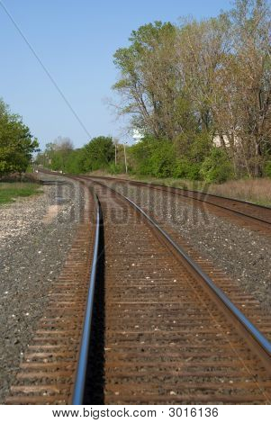 Blue Sky Reflection In Railroad Track