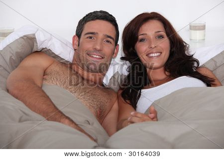 Husband and wife in bed together