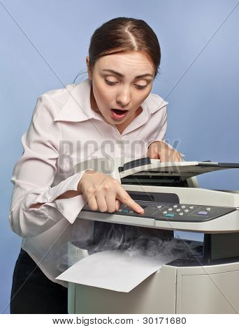 Surprised Woman With Smoking Copier