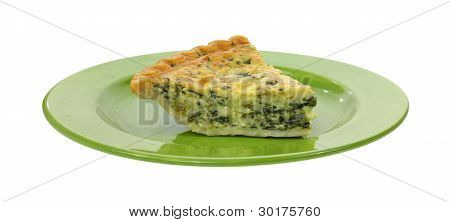 Serving Of Spinach Quiche On Green Plate