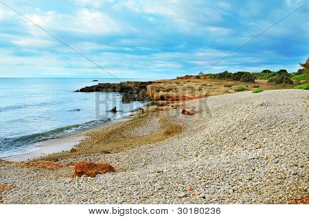 A shingle beach in Alcocebre, Valencia, Spain