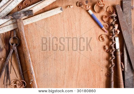 Composition Of Grungy Old Hand Tools On Wood Texture