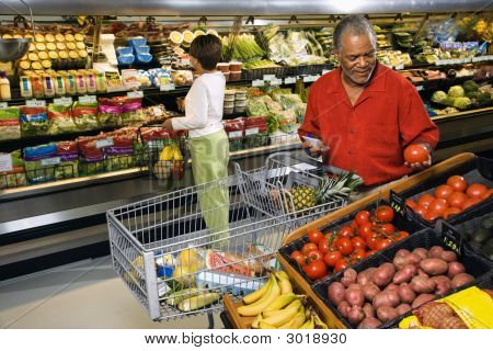 People Shopping For Produce.
